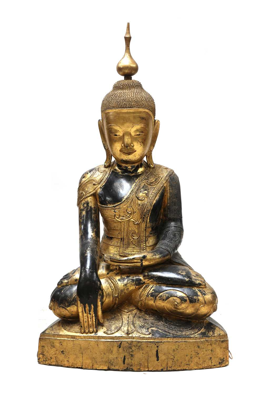 Lot 70 - A large South-East Asian wooden and lacquered Shakyamuni buddha