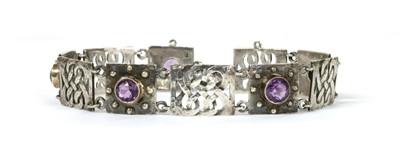 Lot 35 - An Arts & Crafts silver amethyst set bracelet by Murrle Bennett & Co., c.1910