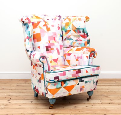 Lot 424 - A wingback armchair