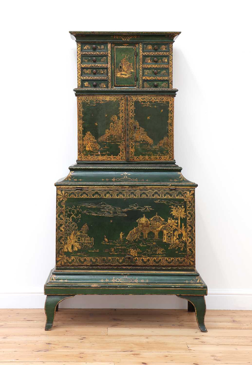Lot 86 - A Northern European green-lacquered and japanned cabinet on stand