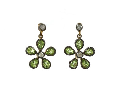 Lot 195 - A pair of silver and gold, peridot and diamond floral cluster earrings
