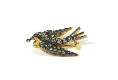 Lot 102 - A silver diamond set swallow brooch