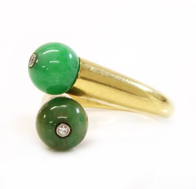 Lot 186 - A two stone jade bead and diamond crossover ring, by Cartier