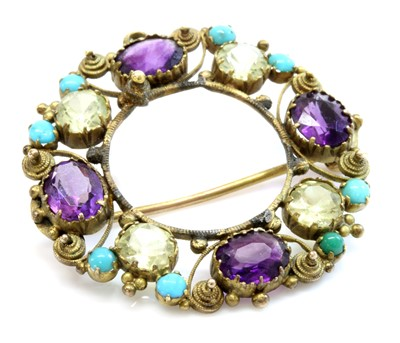 Lot 24 - A Regency gold amethyst, chrysolite and turquoise cannetille brooch/pendant