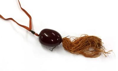 Lot 33 - A cherry coloured Bakelite bead pendant