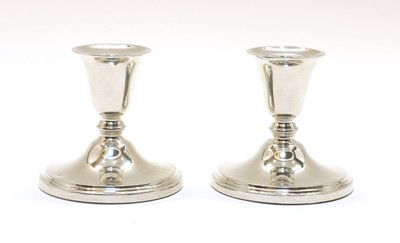 Lot 75 - A pair of silver dwarf candlesticks by Adie & Sons Ltd