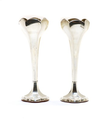 Lot 57 - A pair of Edwardian silver vases with six sided tulip shaped bowls