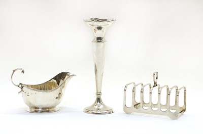 Lot 30 - A modern silver six division toast rack by Elkington & Co
