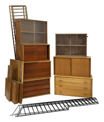Lot 470 - A collection of teak wall-mounted cabinets