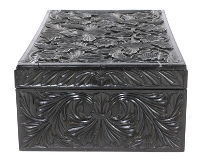 Lot 97 - A Ceylonese carved ebony workbox