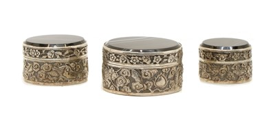 Lot 39 - A set of three graduated silver banded agate boxes