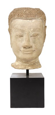 Lot 83 - A carved stone head of Buddha
