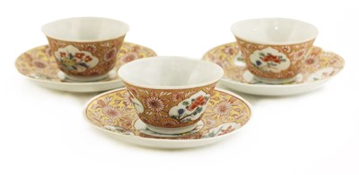 Lot 40 - A collection of three Chinese famille rose tea cups and saucers