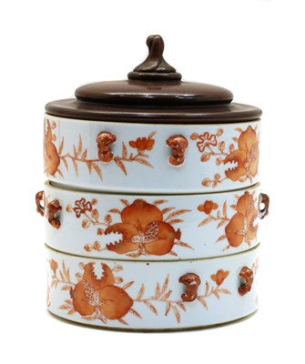 Lot 109 - A Chinese iron-red stacking box