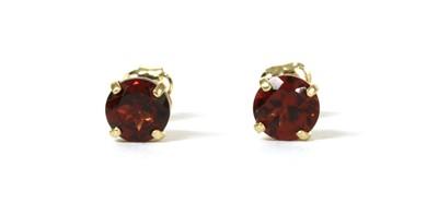 Lot 152 - A pair of gold single stone garnet stud earrings