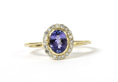 Lot 173 - A gold tanzanite and diamond cluster ring