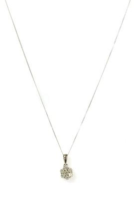 Lot 124 - A white gold diamond daisy cluster pendant