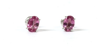Lot 154 - A pair of white gold single stone pink sapphire stud earrings