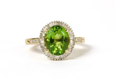 Lot 190 - A gold peridot and diamond cluster ring