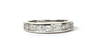 Lot 116 - A white gold diamond half eternity ring