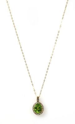 Lot 192 - A gold peridot and diamond cluster pendant
