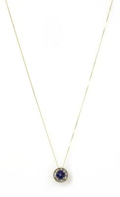 Lot 178 - A gold tanzanite and diamond cluster pendant