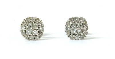Lot 115 - A pair of white gold diamond cluster earrings