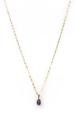 Lot 176 - A gold single stone tanzanite pendant