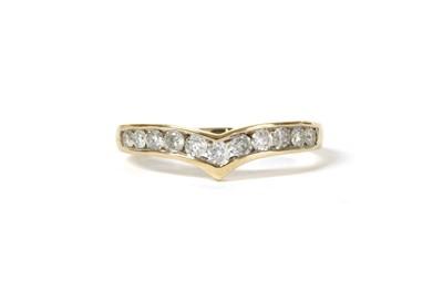 Lot 94 - A gold diamond wishbone-shaped half eternity ring