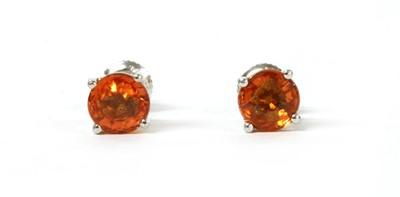 Lot 183 - A pair of white gold single stone orange sapphire stud earrings