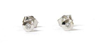 Lot 110 - A pair of white gold single stone diamond stud earrings
