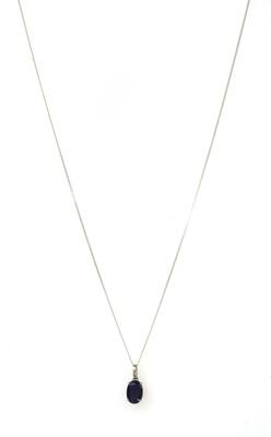 Lot 168 - A white gold single stone sapphire pendant