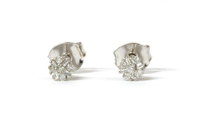 Lot 126 - A pair of white gold diamond cluster stud earrings