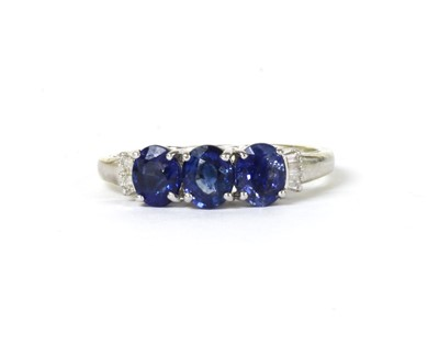Lot 164 - A white gold sapphire three stone ring