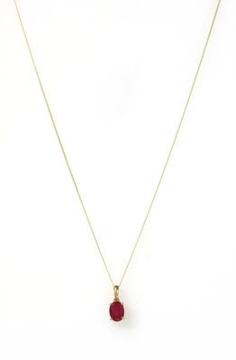 Lot 143 - A gold single stone fracture filled ruby pendant