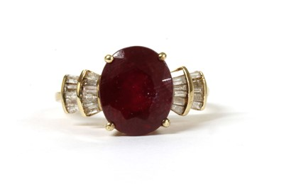 Lot 142 - A gold fracture filled ruby and diamond ring