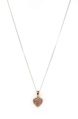 Lot 128 - A rose gold heart-shaped pink diamond pendant