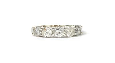 Lot 117 - A white gold five stone diamond ring