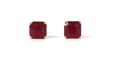 Lot 146 - A pair of gold single stone fracture filled ruby stud earrings