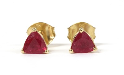 Lot 144 - A pair of gold single stone fracture filled ruby stud earrings