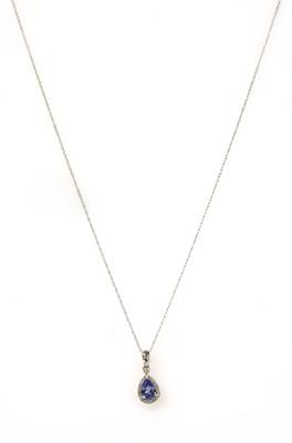 Lot 179 - A white gold tanzanite and diamond cluster pendant