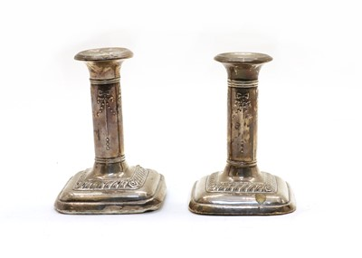 Lot 79 - A pair of  Edwardian weighted silver dwarf candlesticks