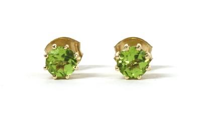 Lot 191 - A pair of gold single stone peridot stud earrings