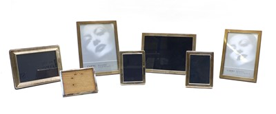 Lot 99 - A collection of seven silver easel backed photograph frames