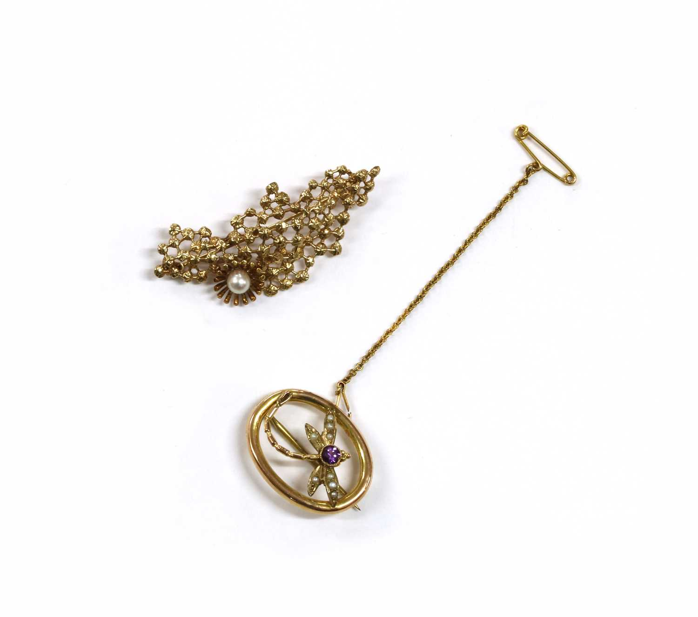 Lot 20 - An Edwardian gold amethyst and split pearl dragonfly brooch