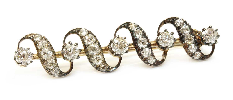 Lot 47 - A late Victorian diamond set ribbon bar brooch, c.1880