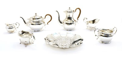 Lot 23 - Two four piece silver-plated tea and coffee sets
