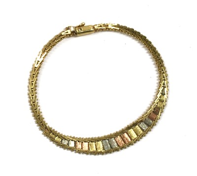 Lot 81 - A 9ct three colour gold bracelet, by Mappin & Webb