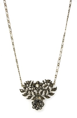 Lot 103 - A silver and gold, diamond set pendant
