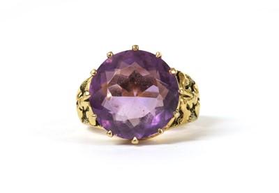 Lot 157 - A gold single stone amethyst ring